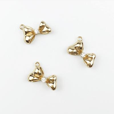 bra charms 1079 gold bow tie with rhinestone
